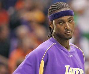 Kwame Brown gets paid $3 million, 10000% more than the average American.  His job is to look tall.