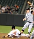 Baltimore Orioles shortstop J.J. Hardy (2) and Seattle Mariners shortstop Brendan Ryan (26)