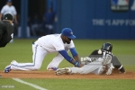 TORONTO, CANADA - MAY 26: Jose Reyes #7 of the Toronto Blue Jays cannot hang on to the ball in the fifth inning during MLB game action as Alexei Ramirez #10 of the Chicago White Sox steals second base on May 26, 2015 at Rogers Centre in Toronto, Ontario, Canada. (Photo by Tom Szczerbowski/Getty Images) *** Local Caption *** Alexei Ramirez; Jose Reyes