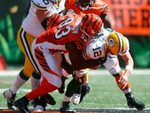 CINCINNATI, OH - SEPTEMBER 22:  Michael Johnson #93 of the Cincinnati Bengals sacks Aaron Rodgers #12 of the Green Bay Packers during their game at Paul Brown Stadium on September 22, 2013 in Cincinnati, Ohio.  The Bengals defeated the Packers 34-30. (Photo by John Grieshop/Getty Images)