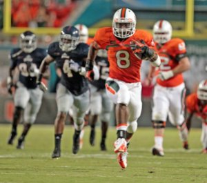 Miami running back Duke Johnson highsteps his way past Florida Atlantic defenders on his way to a 53-yard touchdown run in the second quarter at Sun Life Stadium in Miami Gardens, Florida, on Friday, August 30, 2013. (Al Diaz/Miami Herald/MCT via Getty Images)