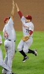 Houston Astros' Carlos Lee (45) celebrates 9-3 win over the Washington Nationals with teammate Jose Altuve (27) in a baseball game, Saturday, Sept. 10, 2011, in Washington. (AP Photo/Nick Wass)