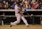 DENVER, CO - APRIL 08:  Jose Abreu #79 of the Chicago White Sox hits a three run home run off of Chad Bettis #35 of the Colorado Rockies to give the White Sox a 7-2 lead in the seventh inning during Interleague play at Coors Field on April 8, 2014 in Denver, Colorado.  (Photo by Doug Pensinger/Getty Images)