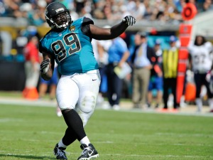 Jacksonville Jaguars defensive tackle Sen'Derrick Marks (99) does a little dance after a big play against the San Diego Chargers during the first half of an NFL football game in Jacksonville, Fla., Sunday, Oct. 20, 2013.(AP Photo/Stephen Morton)
