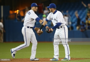 It's still surreal to see Tulo in a Blue Jay uniform. (Photo by Tom Szczerbowski/Getty Images) *** Local Caption *** Troy Tulowitzki; Josh Donaldson