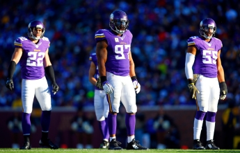 Minnesota Vikings defensive end Everson Griffen (97) free safety Harrison Smith (22) and outside linebacker Anthony Barr (55) line up against the St. Louis Rams during an NFL football game Sunday, Nov. 8, 2015, in Minneapolis. The Vikings won in overtime, 21-18.  (Jeff Haynes/AP Images for Panini)