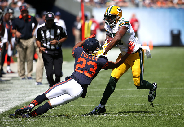 Green Bay Packers wide receiver Davante Adams (17) pushes Chicago Bears cornerback Kyle Fuller (23) aside after a reception by Adams in the first half at Soldier Field in Chicago on Sunday, Sept. 13, 2015. The Packers won, 31-23. (Chris Sweda/Chicago Tribune/TNS via Getty Images)